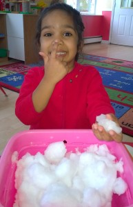 Children touched the snow with bare hands